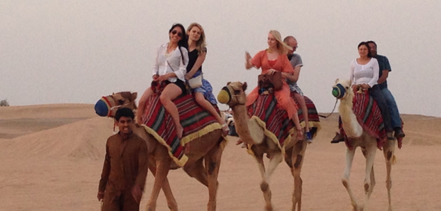 Students ride camels in Dubai as part of Real Estate Around the World
